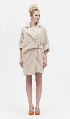 Faux fur coat with bracelet length sleeves and 2 slip-in side pockets. Fastens towards the left hand side with gold metal sliding buckle on a half belt and 2 'invisible' press studs. L87cm Dry clean only.  Code S1C261  WAS $183.88   $91.17