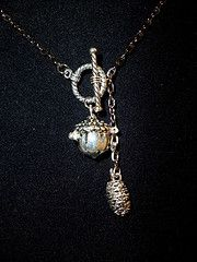 Silver acorn (it opens for a tiny token) and pine cone necklace