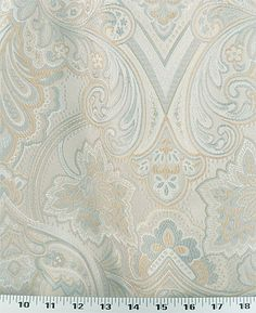 Medium Weight Drapery / Medium Weight Upholstery This large-scale floral woven fabric is a beautiful jacquard in a shimmery beige accented with a light gray-blue and gold.