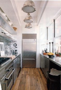Modern galley, nautical lights, stainless open shelving