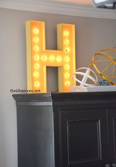 A DIY Lighted Sign looks great in any room of the house. Make one for your child's bedroom and use it as a nightlight.