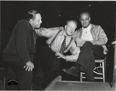 Double weight, original, vintage candid photo of Director Pops Leonard, Nelson Eddy and Herb Stothart on the recording stage going over the lyrics Nelson was recording for New Moon (MGM 1940) - ESCANO COLLECTION