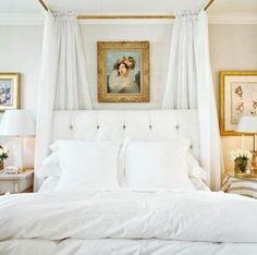 Cream organdy curtains drape around the bed to cocoon this bedroom
