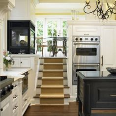 Stairs to a breakfast nook with a shared fireplace