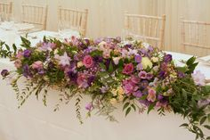 pink purple and lilac top table arrangement