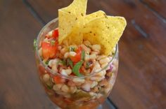 Shoepeg Salsa     submitted by Melanie     2 cans shoepeg corn (drain)     1 can blackeyed peas (drained and rinsed)     1 red bell pepper, diced     1 purple or sweet onion-diced     1 cup of chopped cilantro     1/2 cup wishbone robust italian dressing     1/2 cup wishbone sweet and spicy french dressing     Combine and enjoy!
