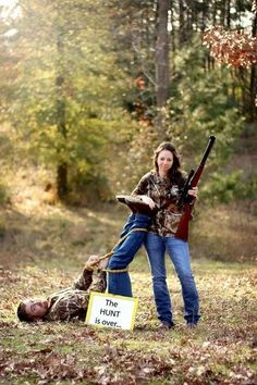 The hunt is over love funny cute photography wedding outdoors trees country hunting guns engagement