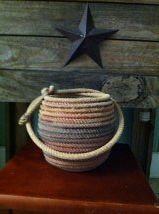 Rope vase I made from recycled ropes. My husband team ropes and I figured I may as well do something constructive with the old ropes left lying around everywhere!