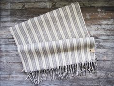 grey striped mexican flannel blanket {sold out it seems} Amazing Grays, Flannel Blanket, Mish Mash, Quilted Pillow, Shades Of White, Cozy House, Grey Stripes, Rugs On Carpet, Blankets