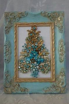 repurposed jewelry/ blue gold frame