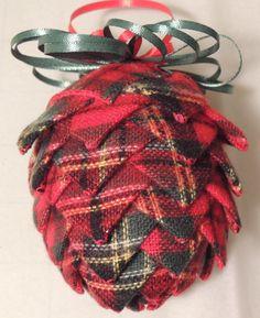 Hot glue festive ribbon to styrofoam egg for a pinecone ornament.