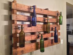 Unique diy wall decor project use wooden pallets to hold wine bottle lights or to put welding caps