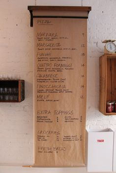 {subtle odes to the butcher, hinting to expertise -- special of the day menu? something rotating -- or packaging} Butcher Paper Menu at Pizzeria Farina in Vancouver Menu Card Design, Menue Design, Menu Restaurant, Restaurant Design, Pizzeria Design, Cafe Bar, Cafe Bistro, Bar Deco, Café Design
