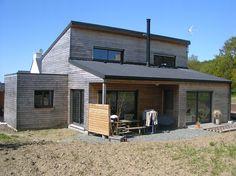 maison ossature bois avec poele a bois