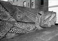 A cast-concrete sculptural wall entitled 'Two Doves' by the artist William Mitchell was erected in Warwick Crescent in Browning's honour. He lived there 1862-1877.
