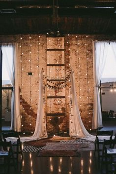 I like the idea of lights down the big doors... even though it wont be dark out during the ceremony?