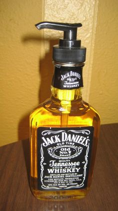 For a guy's bathroom: From empty bottle to soap container! Most twist top glass bottles fit standard dispenser tops.