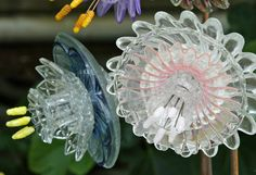 Incredible glass flowers designed and constructed using antique glass (vases, cups, saucers) by Mike Urban  (very talented friends I knew fr...
