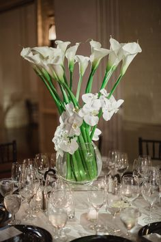 Calla Lilies Wrapped with Orchids   Photo: Shaun Menary Photography. View More: http://www.insideweddings.com/weddings/modern-black-and-white-wedding-with-southern-traditions-in-dallas/916/