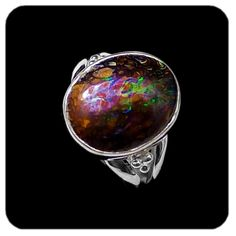 Boulder Opal Matrix. High domed stone with flecks of brilliant greens and other colors against a background of earthy brown ironstone, set in sterling silver. Ref code: 5428. Opal ring - suit ladies or gents fashion jewelry (jewellery)