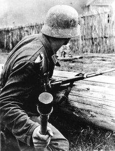 "A German soldier ready to throw a ""potato masher"" grenade (""Stielhandgranate-24"") somewhere on the Eastern Front. The grenade was a weapon the German army had integrated closely with small unit fighting on the very front line."