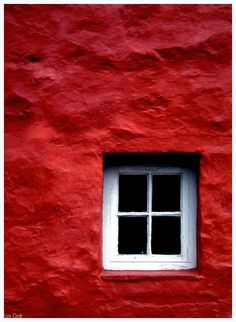 A red sea wall and a white cute window ;)