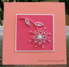all things paper: Quilled Daisy Card, this is simple yet stunning.  Great tutorial as well