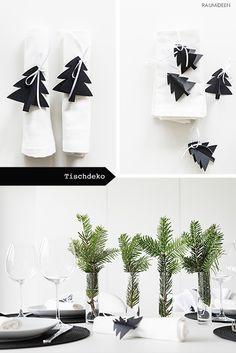 Weihnachtliche Tischdeko mit Tannenbäumen.