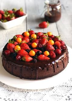 Chocolate cheesecake beautifully topped! Cant seem to the get the recipe (the link is to a blog in a foreign language), but I am sure I can improvise a recipe, and the topping looks to be mixed berries, kumquats, and a chocolate glaze? So pretty, must try!