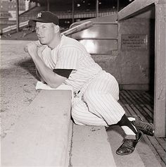Yankee ace Mickey Mantle sits on the dugout steps during batting practice, and seems to be pondering the big question -- whether or not he'll win in his bid to break Babe Ruth's home run record. Mantle made his 42nd home run of the year in the third inning of last night's game against Boston. With 42 games to go, he needs 18 homers to tie Ruth's 1927 mark of 60, and 19 to set a new record. Mantle also seems fairly certain to lead both major leagues in batting percentage, runs scored, and…