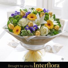 Easter Egg Hand tied.  A bright hand-tied bouquet that would make the perfect Easter Celebration gift - complete with golden foil-wrapped hollow chocolate eggs. Delicious!
