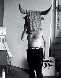 Picasso wearing a bull's head intended for bullfighter's  training
