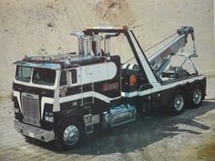Freightliner twin bunk with V8 318 Detroit and early Challenger 1060.
