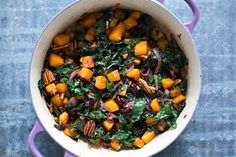 Great side dish for the holidays! Roasted cubes of butternut squashed tossed with balsamic sautéed onions, kale, pecans, dried cranberries. Easy! Comes together in the time it takes to roast the squash. Delicious! #vegan #paleo #ButternutSquash #Kale #HolidaySide