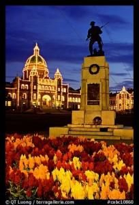 Flowers, memorial statue and illuminated parliament building at night. Victoria, British Columbia, Canada    #KBHomes