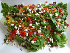 Veggie Wedgie Salad - Hearts of romaine topped with carrots, red bell pepper, corn, English peas, Kalamata olives, tomato, red onion and Feta cheese crumbles. Drizzled with a balsamic reduction.