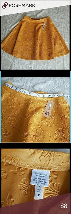 NWT floral print texture skater skirt Size small stretch floral print texture mustard skater skirt. New with tags, no price. jon and anna Skirts Circle & Skater
