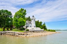 For sale: Round Island Lighthouse in Goetzville, Michigan exterior waterfront. Lighthouse For Sale, Lighthouse Keeper, Unique Homes For Sale, Real Estate Photographer, Lake Huron, Beach House Decor, Coastal Living, Great Places, Beautiful Homes