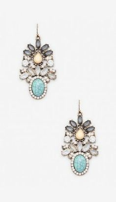 Intricate floral drop earrings with a turquoise-colored stone