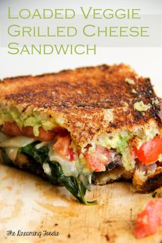 Loaded veggie grilled cheese sandwich - So good! Instead of putting the spinach in the olive oil leave it raw or cook in chicken stock to eliminate some of the oiliness. Otherwise AWESOME sandwich!