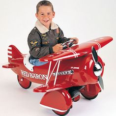 Daddy is a pilot.  Red Baron Pedal Plane from PoshTots #PTRoyalBaby