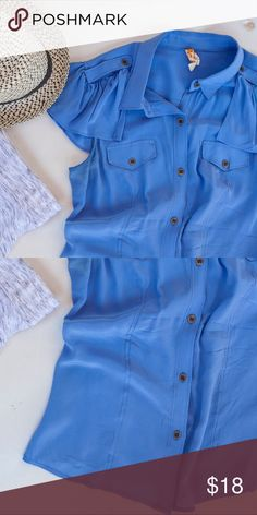 Button down silk blouse with ruffle cap sleeves. This shirt is just too pretty. Soft silk drapes perfectly. I'm a small/medium 34C and the bust is plenty big enough without stretching at the button closure. Anthropologie Tops Blouses