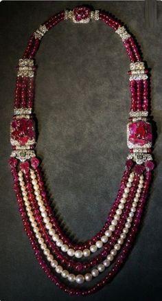An Art Deco platinum, diamond, ruby and pearl sautoir, by Cartier, special order, 1930. #Cartier #necklace #sautoir #ArtDeco