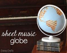 Old globe spray painted and mod podged with sheet music!