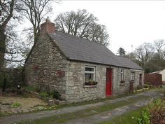Old Stone Cottage Navan, Ireland. How cozy!!! Saw many just like it, with bright red doors. :)