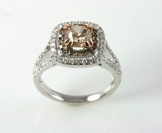 White gold double halo split shank ring with cushion cut chocolate diamond, surrounded by chocolate diamonds.