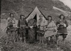 Joseph F. Rock with local Chinese people in the mountains of southwest China.***