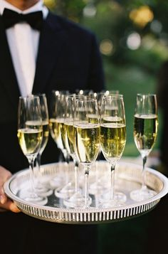 Wedding ceremony idea, greet your guests with sparkling water & champagne as they arrive for the ceremony.