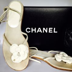 Chanel flat sandals Gently worn Authentic Chanel sandals. Very comfortable and beautiful white  Patent leather Camellia. CHANEL Shoes Sandals