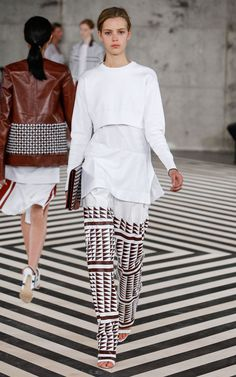 Spring 2014 | EDUN | Look 18 | Tech Nylon Crop Crew, Side Slit Crew, Triangle Print Box Leather Pleat Pant, Graphic Hand Weave Clutch, Manolo Blahnik